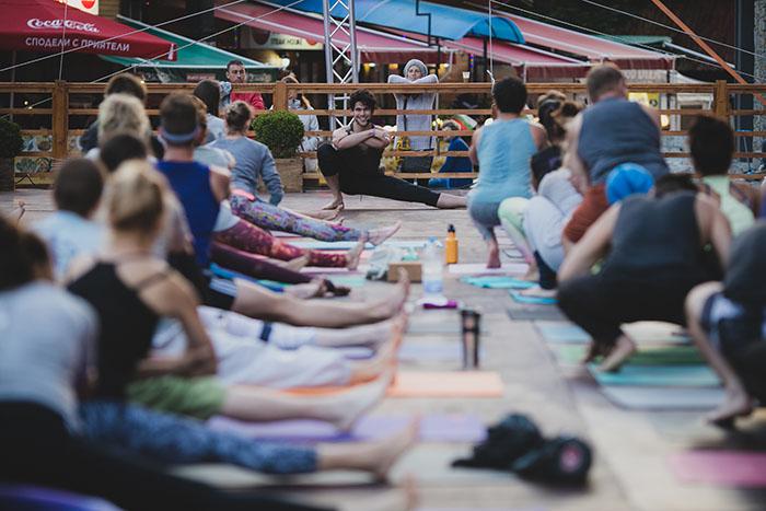 adam husler yoga instructor teaching yoga class