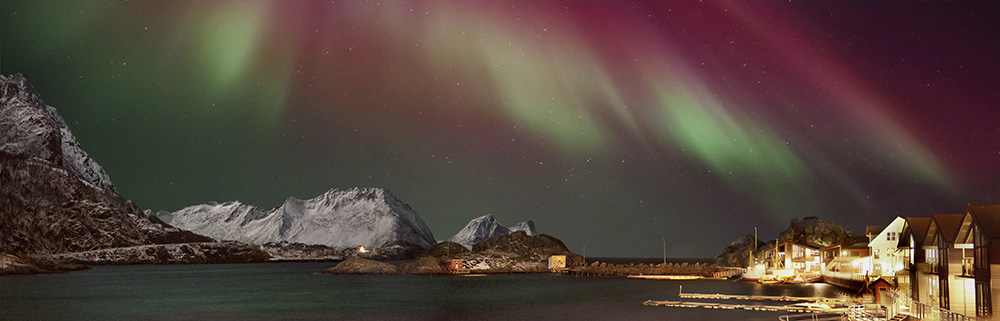 norway winter yoga retreat northern lights over the mountains