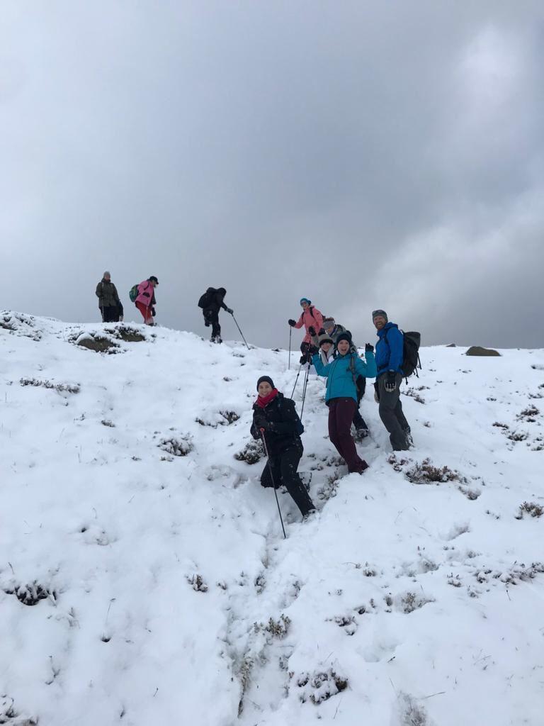 yoga retreat friends climbing snowy mountain team work